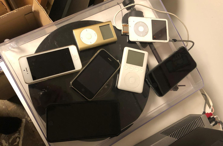 The collection of old iPods and disused iPhones that Smith uses to collect his music